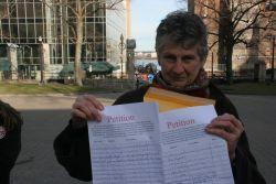 Marike Finlay Holds Petition Against Open Pen Salmon Farming on the Eastern Shore. [Photo: Miles Howe]