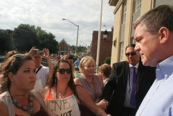 Grassroots women address Premier David Alward. [Photo: Miles Howe]