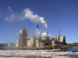 Irvings are the greatest polluter in New Brunswick. Photo shows its notorious Saint John pulp and paper mill – Alex Vye, 2003