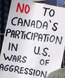 Harper, military monopolies sell arms and Innu land in Paris
