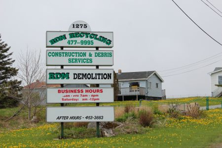 The RDM Recycling facility at 1275 Old Sambro Road has been shut down since January of 2013. Residents would repeatedly try calling the number listed to report after-hours activity, but there would be no answer. {Photo: R. Hussman]