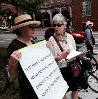 Carrying signs today in front of the Public Gardens